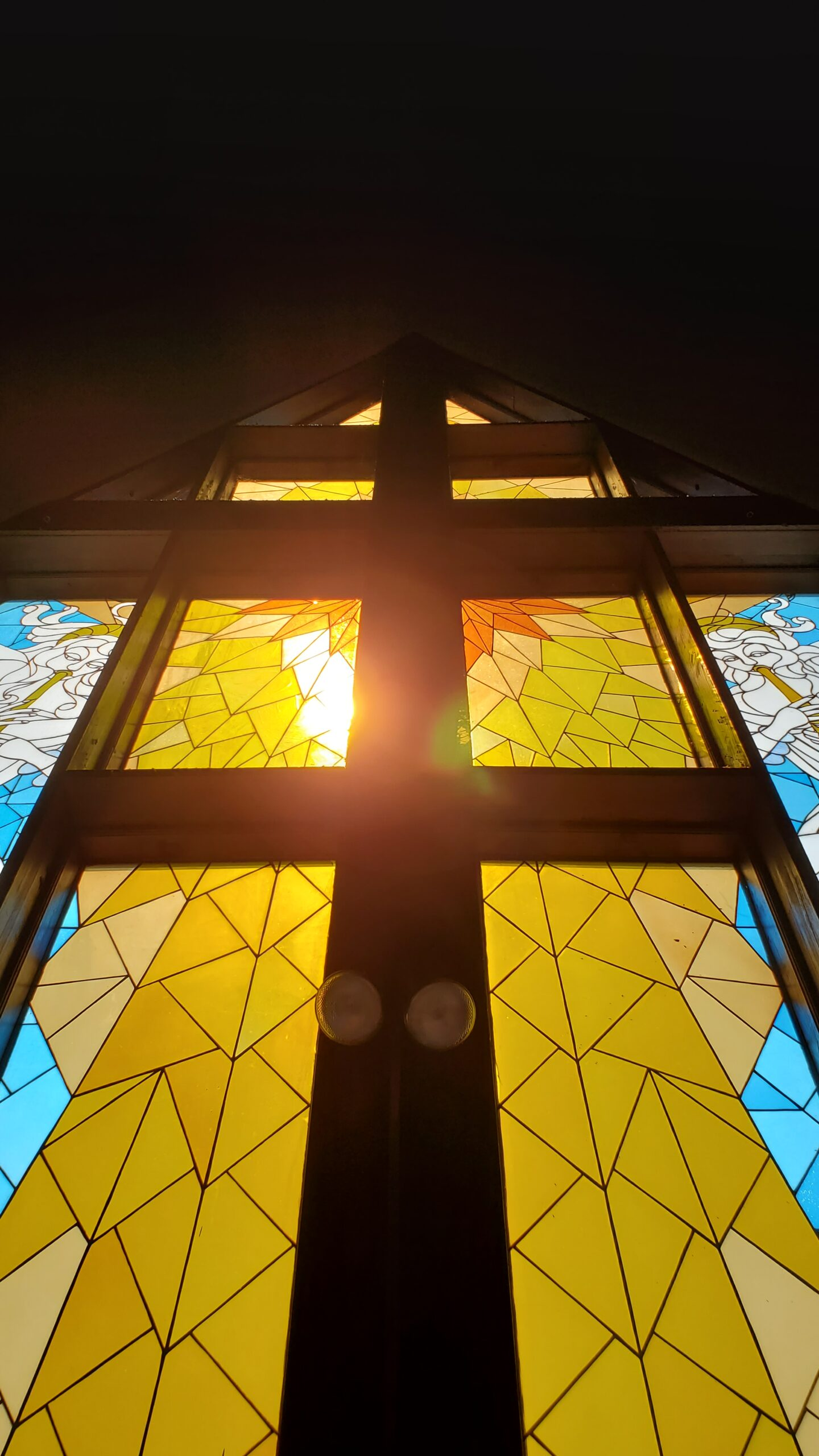 stained glass window with light streaming through