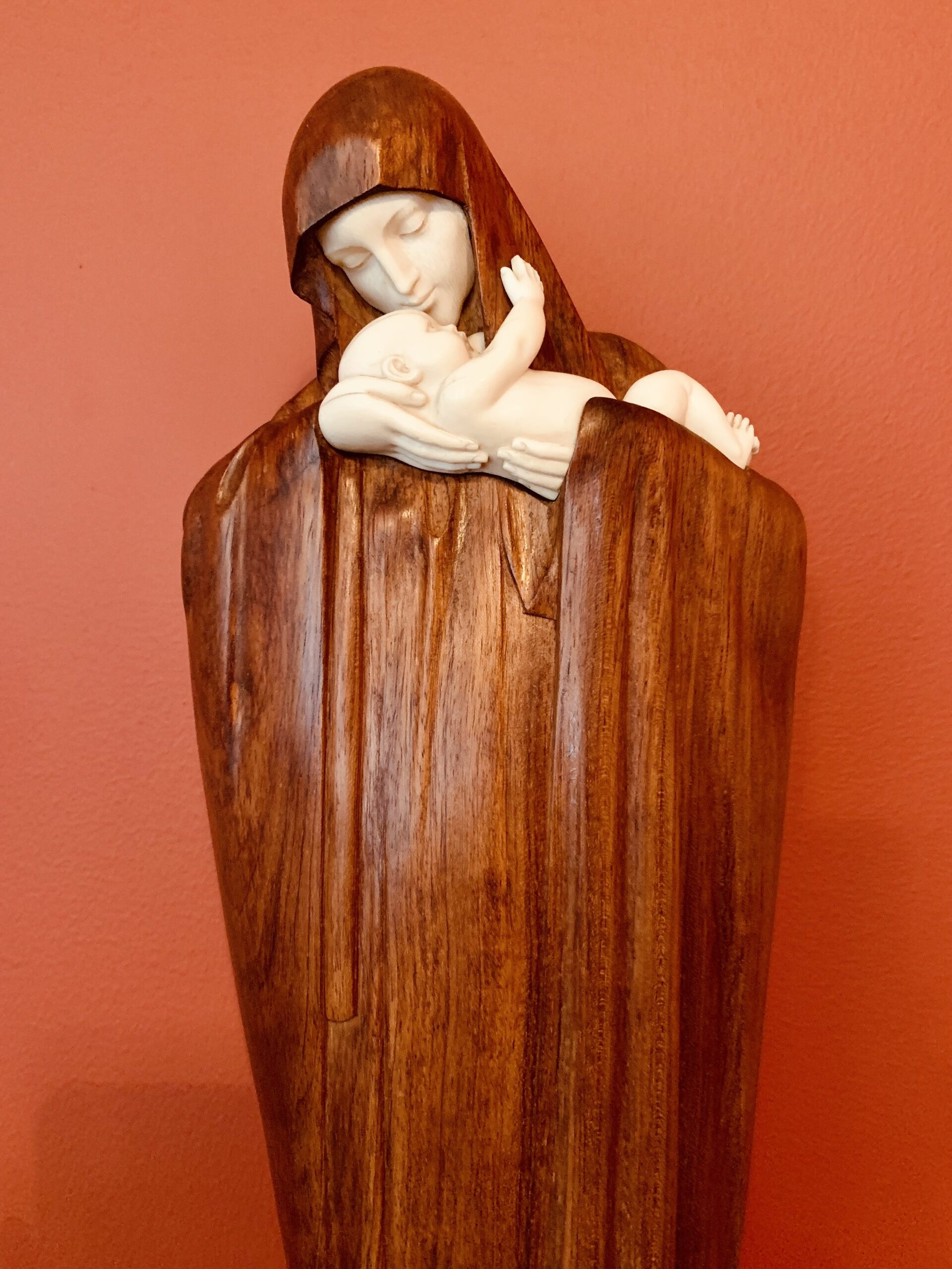 wooden statue of mary with infant jesus