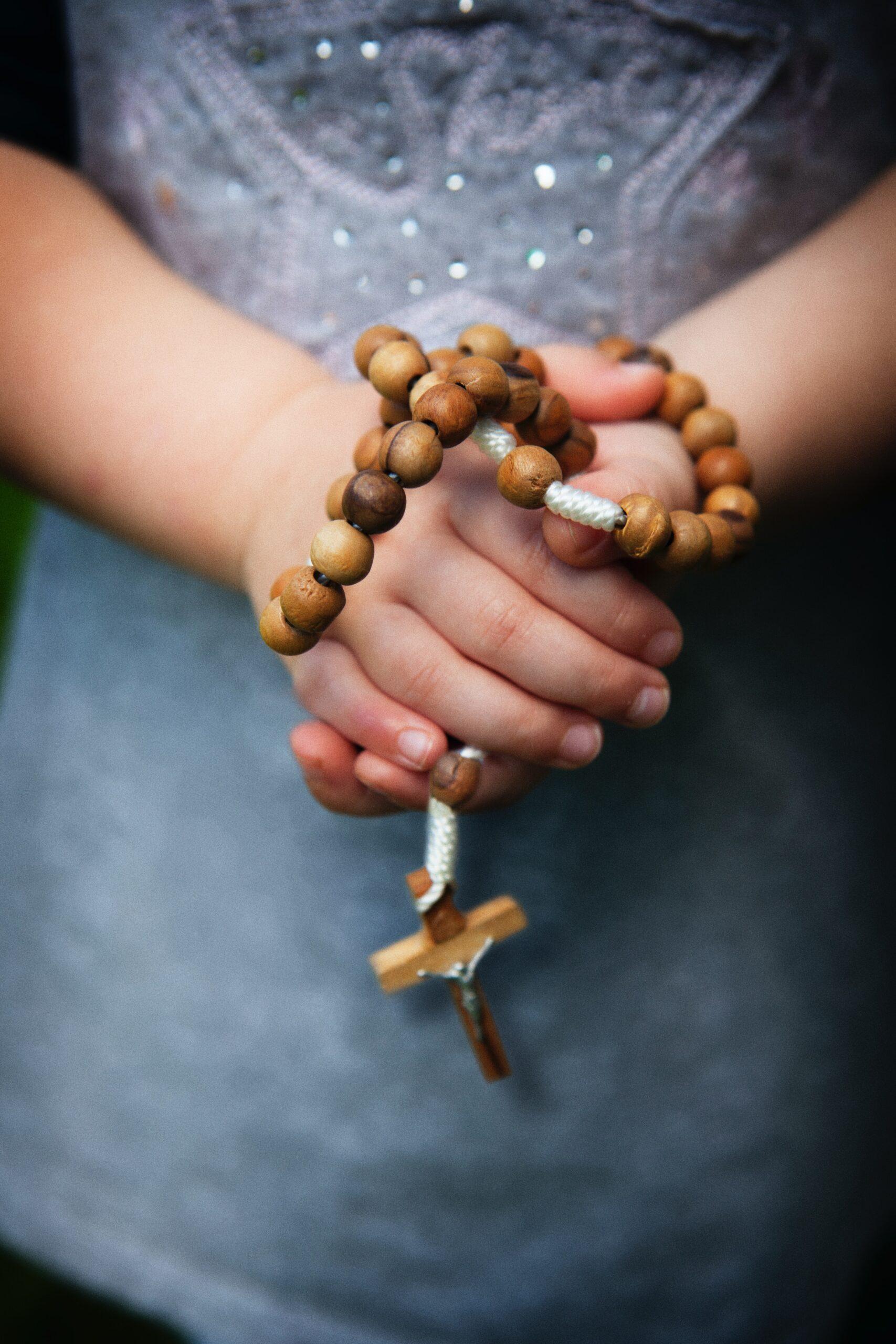 child holding rosary